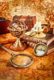 Vintage magnifying glass lies on an ancient world map Royalty Free Stock Image