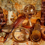 Vintage magnifying glass lies on an ancient world map Royalty Free Stock Photos