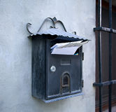 Vintage mailbox. On a wall full of letters Stock Photos