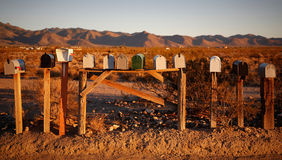 Vintage mailboxes. Several mailboxes in the desert during sunset Stock Photo
