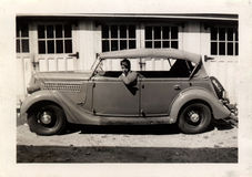 Vintage Man In Car. Vintage photo of a young man in a car. Circa 1937 Stock Photography