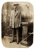 Vintage Man in Checked Suit. Early 1900 portrait of a young man in a checked suit with cigar in hand stock images