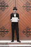 Vintage Man Holding Sign Royalty Free Stock Image