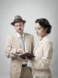 Vintage manager and secretary working together Stock Image