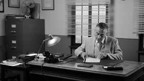 Vintage manager working at desk stock footage