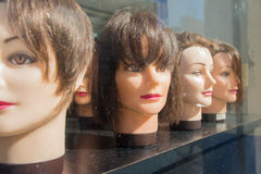 Vintage Mannequin Heads in window display stock images