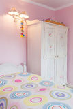 Vintage mansion - girly bedroom. Vintage mansion - a girly bedroom with a colorful bed and a white wardrobe Stock Images