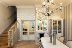 Vintage mansion - luxurious interior. Vintage mansion - a luxurious interior with stairs and a dining area stock photography