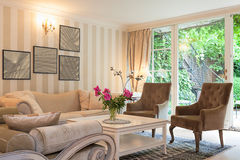 Vintage mansion - luxurious suite. Vintage mansion - a luxurious suite in a beige living room stock images
