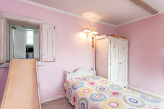 Vintage mansion - pink room. Vintage mansion - a pink room with a slide and a bed Stock Photography