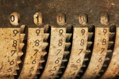 Vintage manual adding machine isolated - 1000. Vintage manual adding machine isolated on white, selective focus - 1000 stock photography