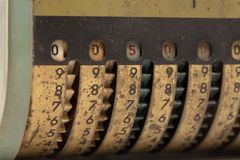 Vintage manual adding machine isolated - 500. Vintage manual adding machine isolated on white, selective focus - 500 royalty free stock photography