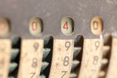 Vintage manual adding machine isolated - 4. Vintage manual adding machine isolated on white, selective focus - 4 royalty free stock images