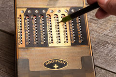 Vintage manual calculator from 1930s with a stylus.  Stock Images