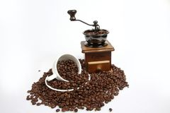Vintage manual coffee with coffee beans,with full coffee beans white cup Stock Photo