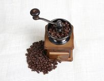Vintage manual coffee with coffee beans Stock Images
