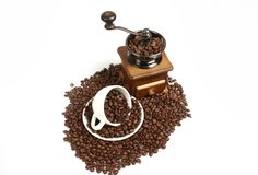 Coffee Mill with cup and coffee beans Royalty Free Stock Photo