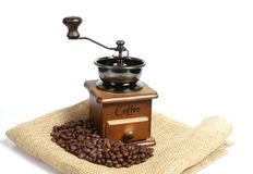 Vintage manual coffee with coffee beans Royalty Free Stock Images