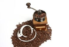 Vintage manual coffee with coffee beans,white backgrounds Royalty Free Stock Photos