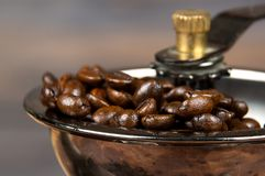 Vintage manual coffee grinder with coffee beans. Vintage manual coffee grinder with coffee beans Royalty Free Stock Photography
