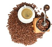 Vintage manual coffee grinder with coffee beans. Isolated antique coffee grinder and coffee beans Stock Photography
