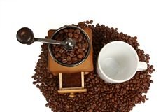 Vintage manual coffee grinder with coffee beans. Isolated antique coffee grinder and coffee beans Royalty Free Stock Photography