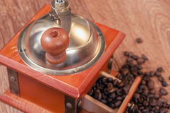 Vintage manual coffee grinder with beans Stock Photography