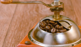 Vintage manual coffee grinder with beans Stock Images