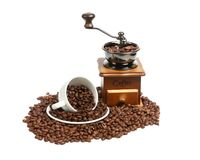Vintage manual coffee grinder with coffee beans on wooden spoon. Isolated antique coffee grinder and coffee beans Stock Photography