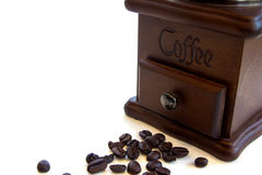 Vintage manual coffee grinder with coffee beans isolated on white background. Vintage coffee grinder with coffee beans Royalty Free Stock Photo