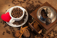 Vintage manual coffee grinder with coffee beans Royalty Free Stock Photo