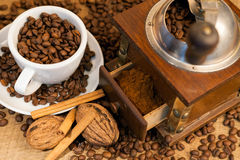 Vintage manual coffee grinder with coffee beans Stock Photo