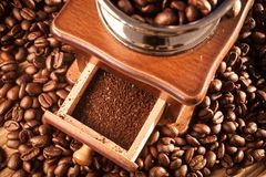 Vintage manual coffee grinder with coffee beans Stock Image