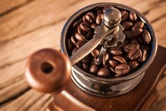 Vintage manual coffee grinder with coffee beans Stock Photography
