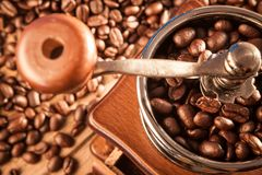 Vintage manual coffee grinder with coffee beans Royalty Free Stock Image