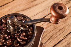 Vintage manual coffee grinder with coffee beans Stock Images
