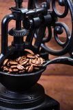 Vintage manual coffee grinder with coffee beans on wooden brown Royalty Free Stock Images