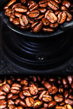 Vintage manual coffee grinder with coffee beans on wooden brown Royalty Free Stock Photo