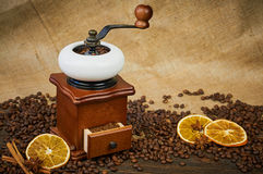 Vintage manual coffee grinder. Roasted coffee beans on the table. Selective focus Stock Photo