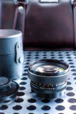 Vintage manual photographic camera lens on metalic background Stock Images
