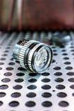 Vintage manual photographic camera lens on metallic background Stock Photos