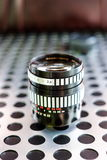 Vintage manual photographic camera lens on metallic background Stock Images