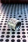 Vintage manual photographic camera lens on metallic background Royalty Free Stock Image