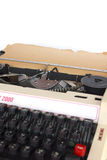 Vintage manual typewriter, with sheet of aged notepaper providin Stock Image