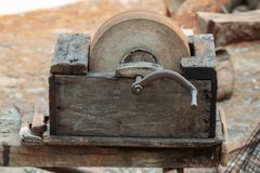 Vintage Manual Wooden Grinder Wheel with Crank.  royalty free stock photography