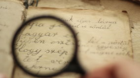 Vintage manuscript and magnifying glass. stock video