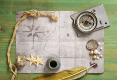 Vintage map and accessories for the treasure hunt Stock Photo
