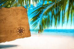 Vintage map and tropical island, travel concept. Vintage map and beautiful tropical island, travel concept Royalty Free Stock Image