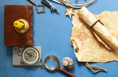Vintage map, compass, magnifier - adventure and treasure Royalty Free Stock Photos