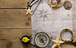 Vintage map, compass, magnifier - adventure and treasure Stock Photos